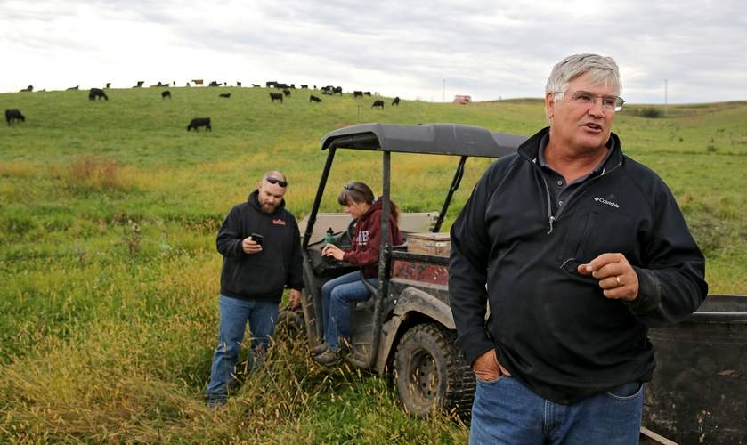 Doug Darrow of Oxford talks during a Mob Grazing Field Day on his farm in Oxford...